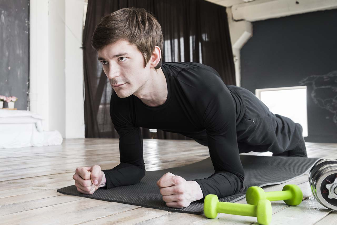 sportsman-doing-plank-exercises-mat 2